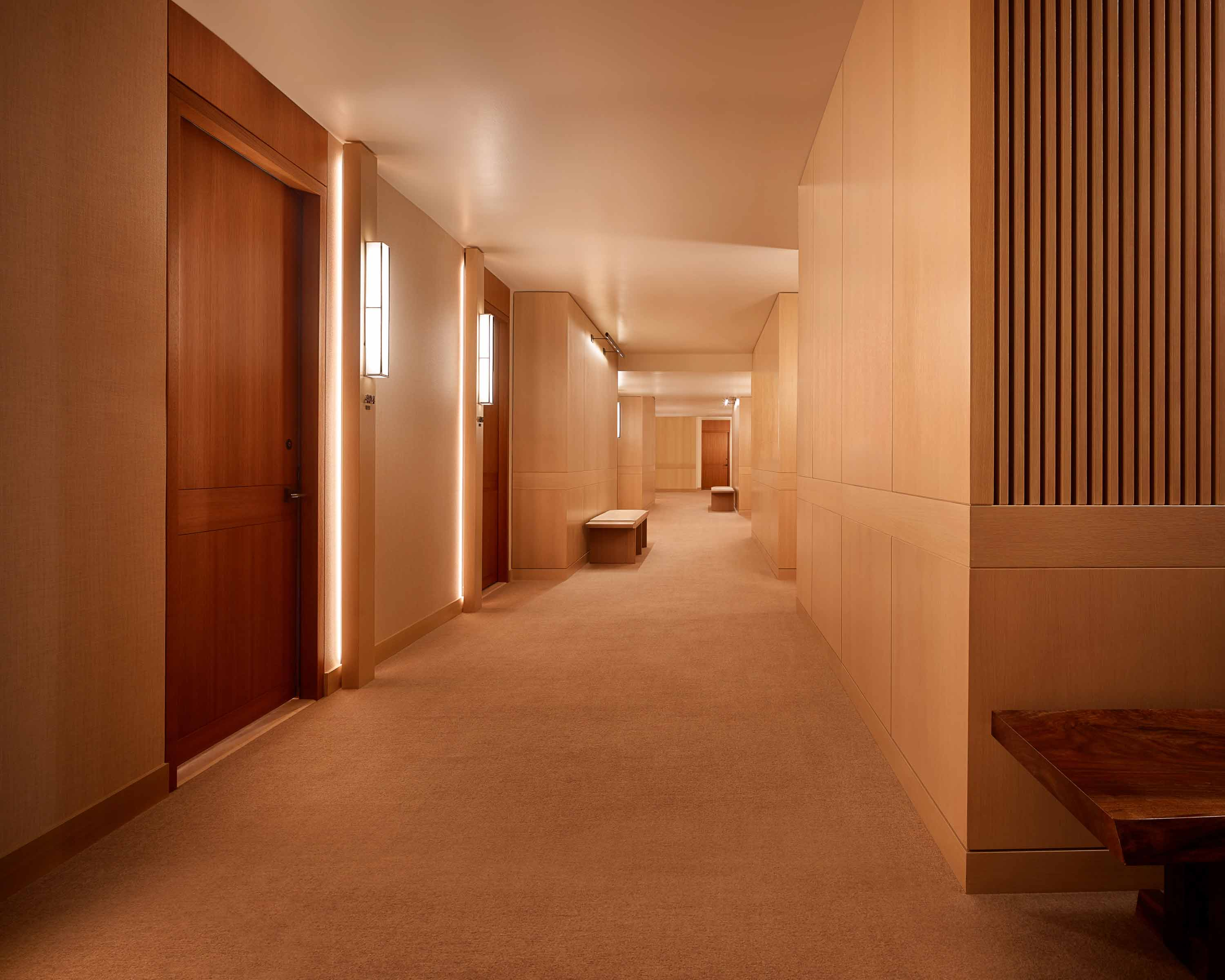 guest corridor with doors to rooms and suites