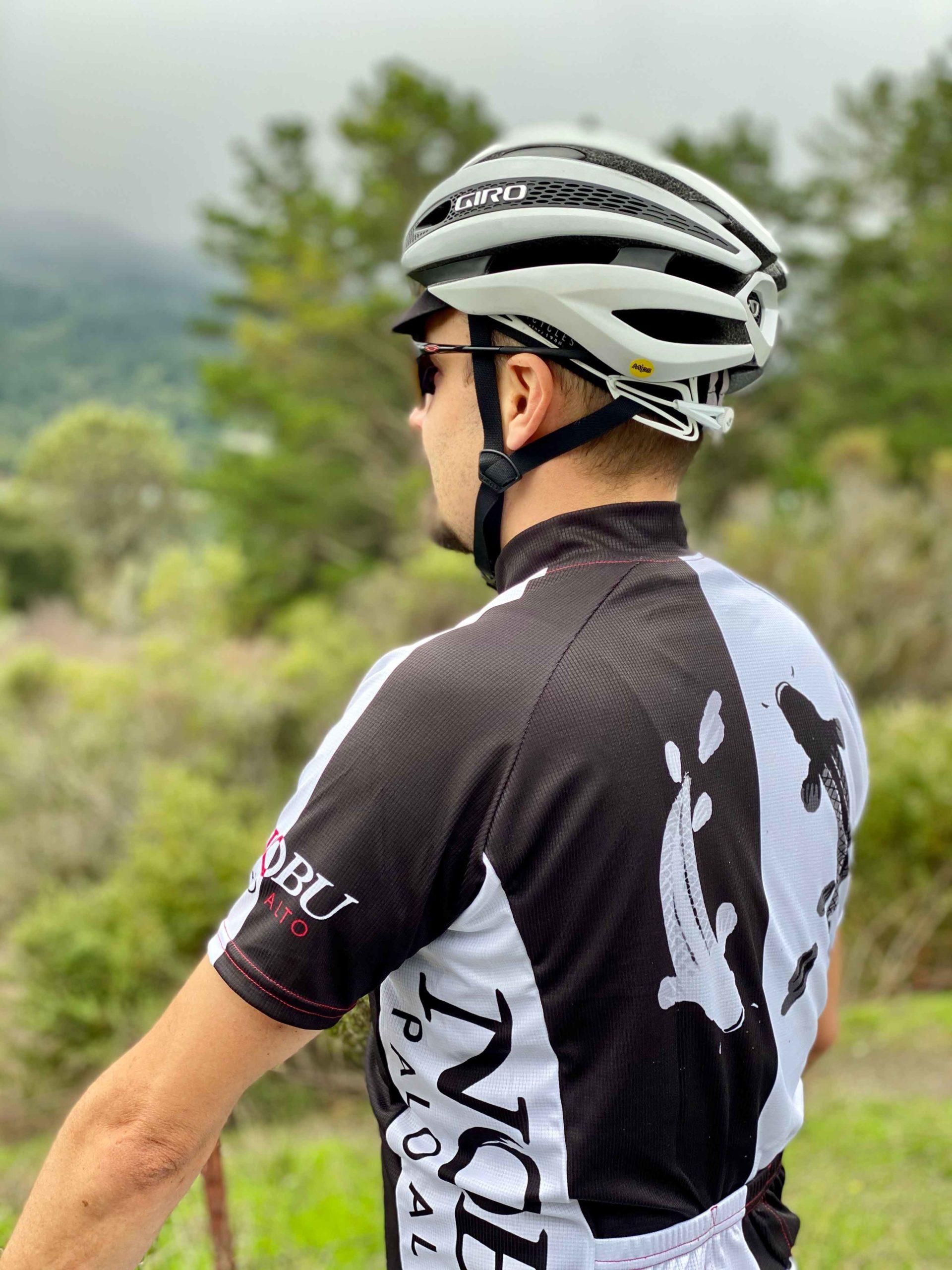 man in Nobu Palo Alto cycling shirt and bike helmet